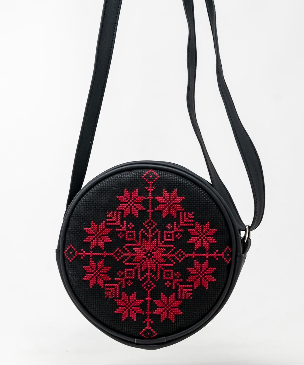 حقيبة دائرية الشكل ( باللون الأحمر والأسود)