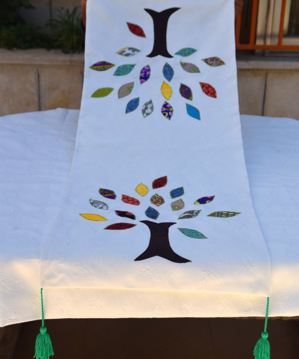 White runner with the tree of life
