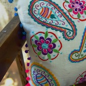 White pillow with colorful decorations