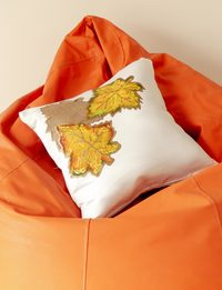 White Satin Cushion with Leaves