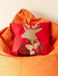 Red Cushion with Dear Head Decoration