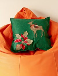 Green Cushion with Small Dear Decoration