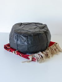 Set of Carpet and Black Leather Pouf