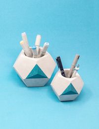 A Set Of Two Pen Holders