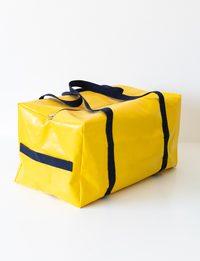 حقيبة سفر يدوية باللون الأصفر