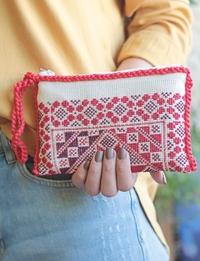 حقيبة يد بيضاء وحمراء
